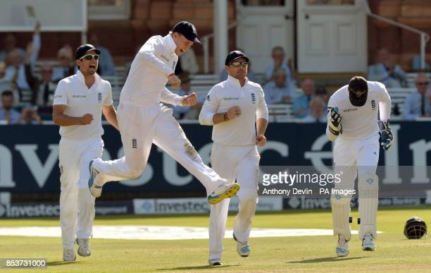 England's Alastair Cook Joe Root and Ian Bell celebrate after Matt Prior took the catch of India's Cheteshwar Pujara during day three of the second...