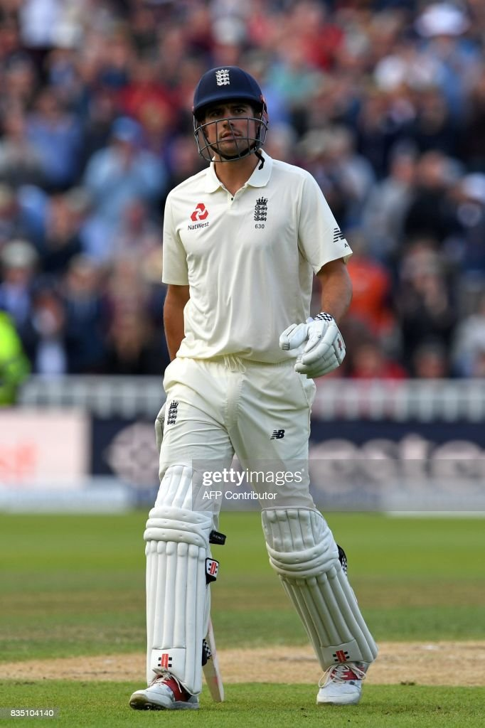 England's Alastair Cook leaves the field after losing his wicket for 243 during play on day 2 of the first Test cricket match between England and the West Indies at Edgbaston in Birmingham, central England on August 18, 2017. England declared on 514 for 8 in their first innings. / AFP PHOTO / Paul ELLIS / RESTRICTED
