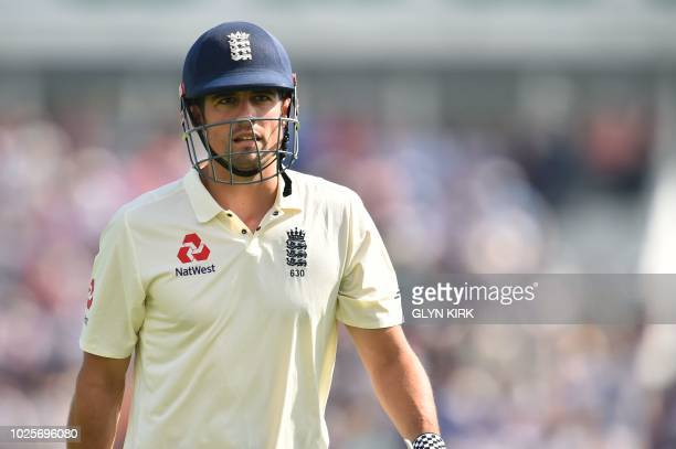 England's Alastair Cook leaves the pitch after losing his wicket for 12 during the third day of the fourth Test cricket match between England and...