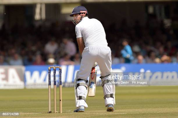 England's Alastair Cook lookson as he is caught behind by India's MS Dhoni off the bowling of Bhuvneshwar Kumar for 10 during day two of the second...