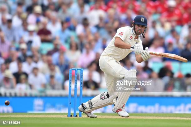 England's Alastair Cook plays a shot during play on the day 3 of the third Test match between England and South Africa at The Oval cricket ground in...