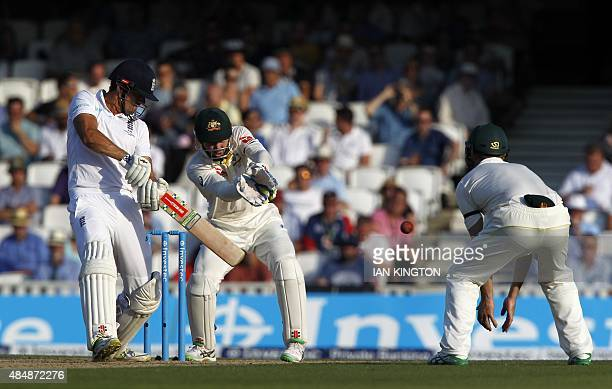 Englands Alastair Cook plays a shot watched by Australias wicketkeeper Peter Nevill during play on the third day of the fifth Ashes cricket test...