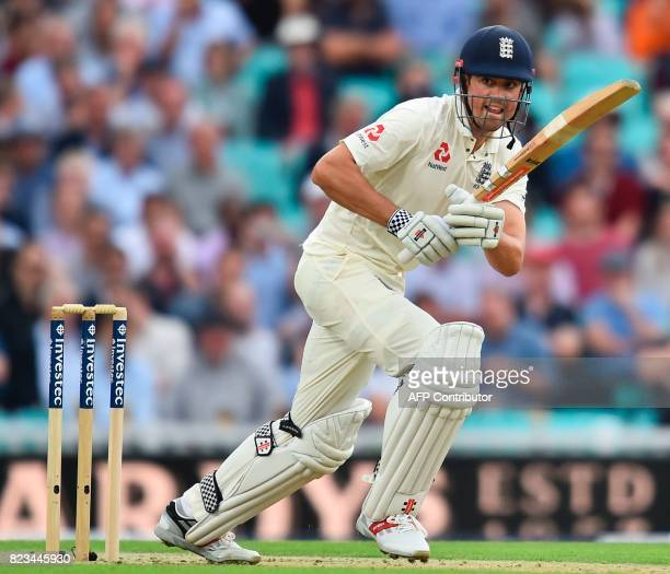 England's Alastair Cook sets off for a run on the first day of the third Test match between England and South Africa at The Oval cricket ground in...