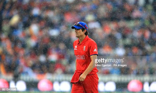 England's Alastair Cook trudges off as the rain falls during the ICC Champions Trophy Final at Edgbaston Birmingham