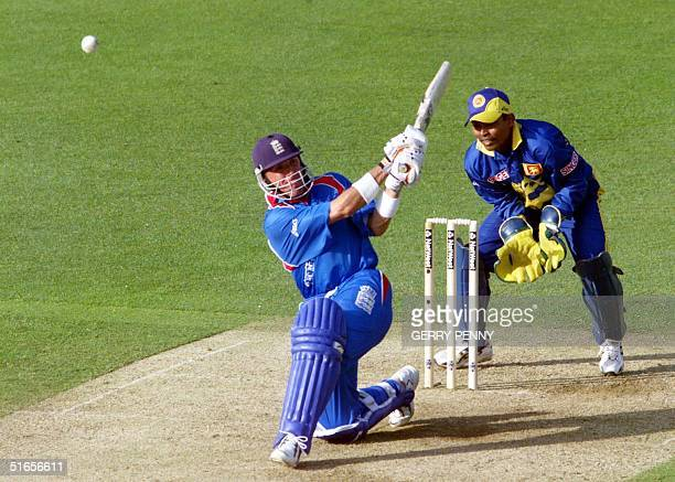 England's Alec Stewart skies a shot off the bowling of Muttiah Muralitharan as they chase Sri Lanka's total of 204 runs 14 May 1999 during the first...