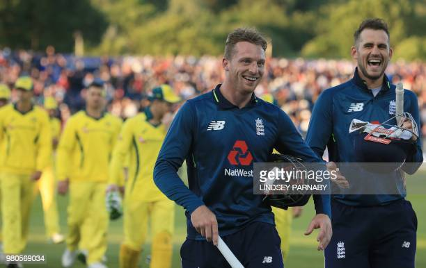 England's Alex Hales and England's Jos Buttler leave after winning the fourth One Day International cricket match between England and Australia at...