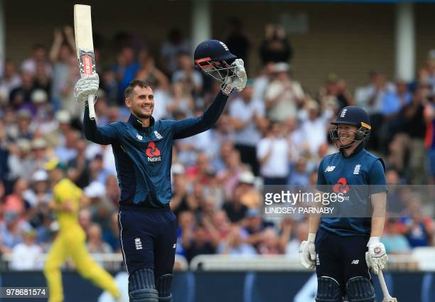 England's Alex Hales celebrates his century as England's Eoin Morgan looks on during the third OneDay International cricket match between England and...