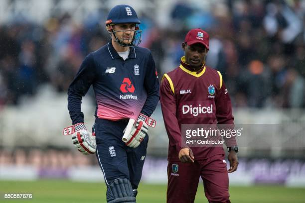 England's Alex Hales leaves the pitch due to a rain delay during the second OneDay International cricket match between England and the West Indies...