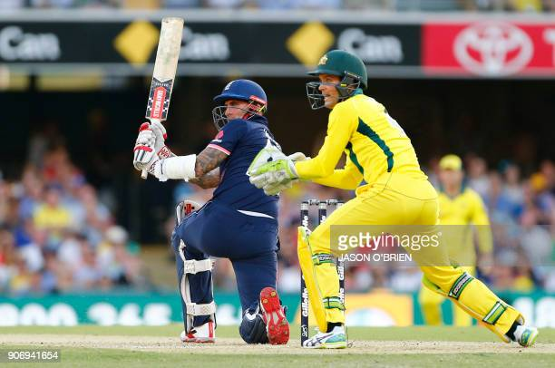 England's Alex Hales plays a shot as Australia's Alex Carey looks on during the oneday international cricket match between England and Australia in...
