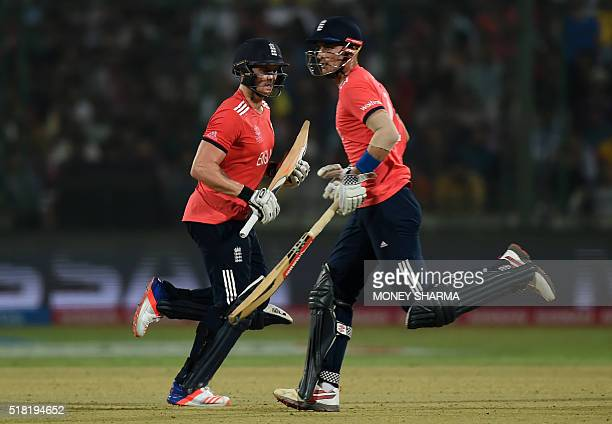 England's Alex Halesand Jason Roy run between the wickets during the World T20 cricket tournament semifinal match between England and New Zealand at...