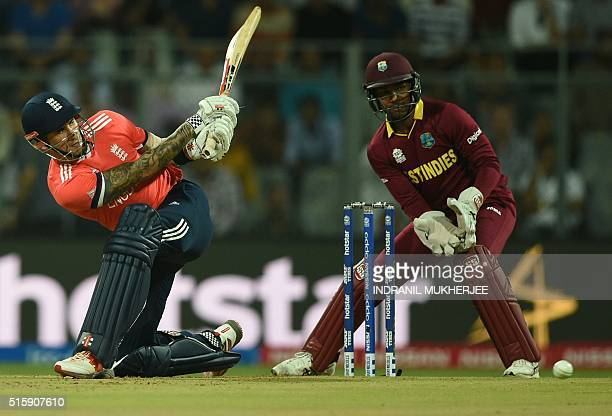 England's Alex Halesis watched by West Indies's wicketkeeper Denesh Ramdin as he plays a shot during the World T20 match between West Indies and...