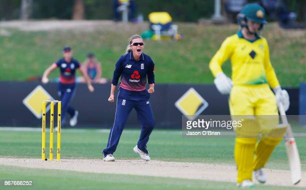 England's Alex Hartley celebrates the wicket of Elyse Villani during the Women's International One Day match between Australia and England on October...