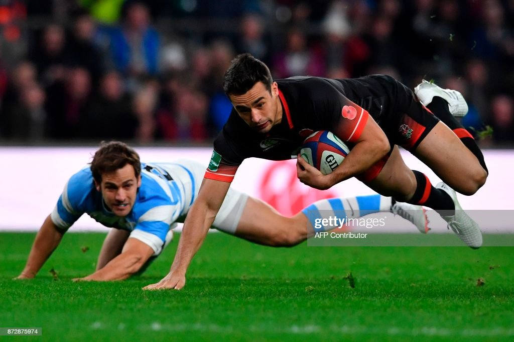 TOPSHOT - England's Alex Lozowski (R) gets taken down after a surging run by Argentina's Nicolas Sanchez (L) during the Autumn international rugby union test match between England and Argentina at Twickenham Stadium in southwest London on November 11, 2017. / AFP PHOTO / Ben STANSALL