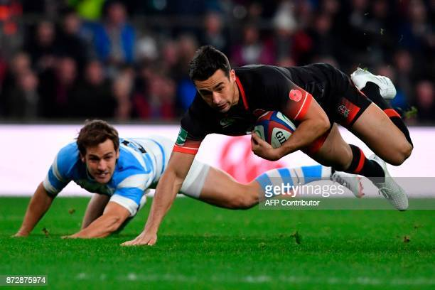TOPSHOT England's Alex Lozowski gets taken down after a surging run by Argentina's Nicolas Sanchez during the Autumn international rugby union test...