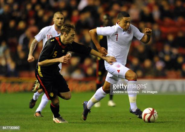 England's Alex OxladeChamberlain and Belgium's Laurens De Bock battle for the ball during the UEFA European Championship 2013 Under21 Qualifying...