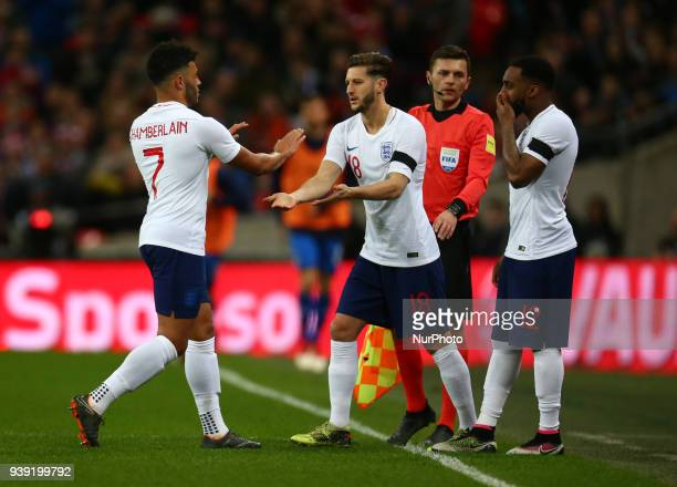 England's Alex OxladeChamberlain comes off and England's Adam Lallana comes on and England's Danny Rose during International Friendly match between...