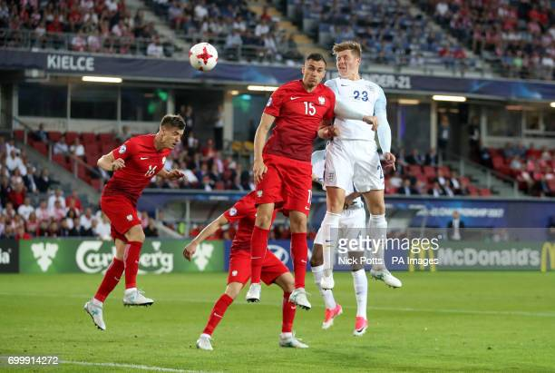 England's Alfie Mawson and Poland's Jaroslaw Jach battle for the ball during the UEFA European Under21 Championship Group A match at the Kolporter...