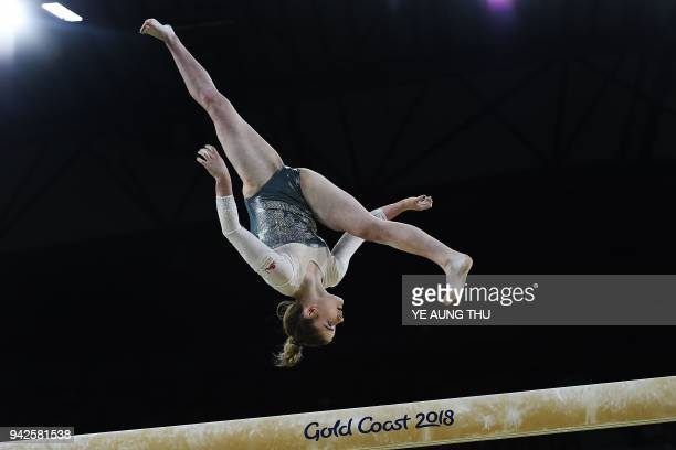 England's Alice Kinsella competes on the balance beam during the women's team final and individual qualification in the artistic gymnastics event...