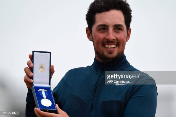 England's amateur golfer Alfie Plant poses with his award after winning the amateur's Silver Medal at British Open Golf Championship at Royal...
