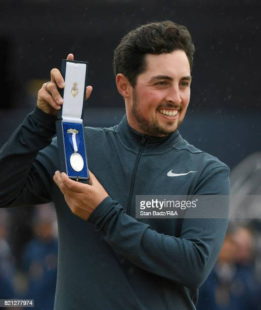 England's amateur golfer Alfie Plant poses with his award after winning the amateur's Silver Medal during the final round of the 146th Open...
