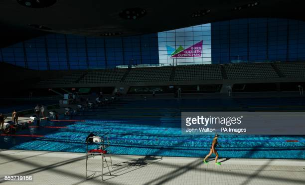 England's Amelie Maughan strides out attached to a bungee cord before jumping in and swimming back during the training session at the London Aquatics...