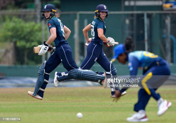 England's Amy Jones and Lauren Winfield run between the wickets during the oneday practice cricket match between the Sri Lanka Emerging team and the...