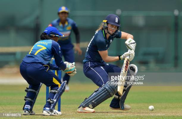 England's Amy Jones plays a shot during the oneday practice cricket match between the Sri Lanka Emerging team and the England team at the Paikiasothy...