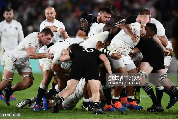 England's and New Zealand's players take part in a maul during the Japan 2019 Rugby World Cup semifinal match between England and New Zealand at the...