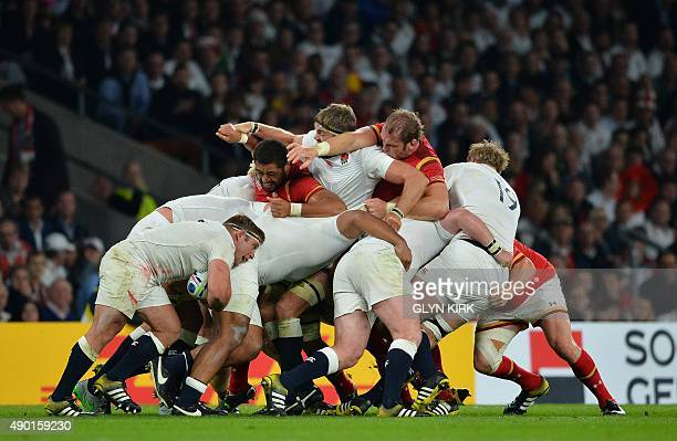England's and Wales' players vie in a maul during a Pool A match of the 2015 Rugby World Cup between England and Wales at Twickenham stadium south...