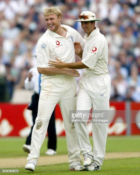 England's Andrew Flintoff celebrates taking the wicket of West Indies Dave Mohammed with Michael Vaughn during the third day of their third npower...