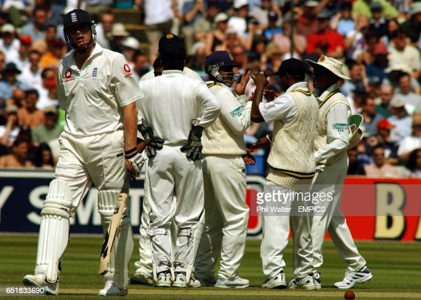 England's Andrew Flintoff leaves the pitch after being caught by Sri Lanka's Hashan Tillakaratne off the bowling of Muttiah Muralitharan