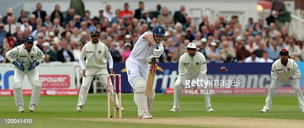England's Andrew Strauss watches his shot during the first day of the second cricket test match against India at Trent Bridge in Nottingham central...