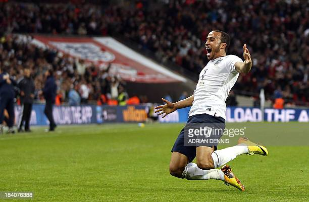 England's Andros Townsend celebrates scoring his team's third goal during the World Cup 2014 Group H Qualifying football match between England and...