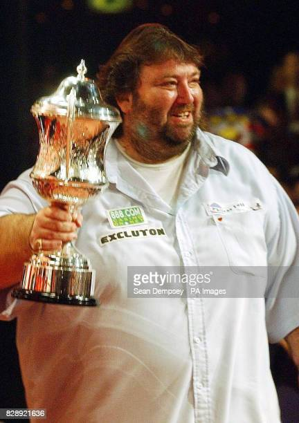 England's Andy Fordham celebrates with the trophy after winning the Final of the Lakeside World Professional Darts Championships against England's...