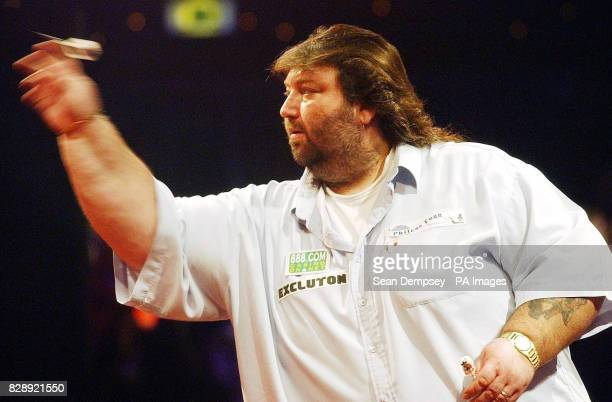 England's Andy Fordham in action against Mervyn King during the Final of the Lakeside World Professional Darts Championships at the Lakeside Country...