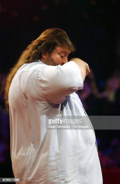 England's Andy Fordham shows his frustration during the Final of the Lakeside World Professional Darts Championships against England's Mervyn King at...
