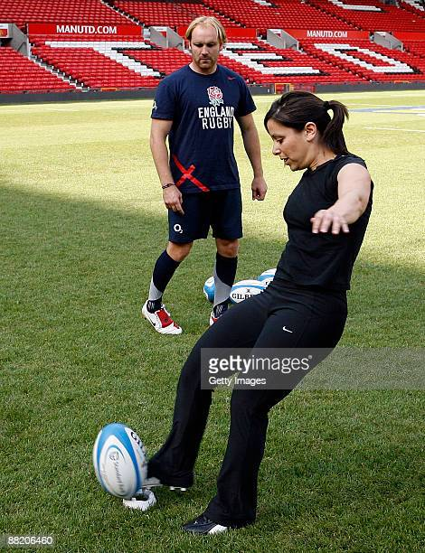 England's Andy Goode watches on as Gail Davis of Sky Sports News kicks for goal during a kicking clinic for media at Old Trafford on June 4 2009 in...