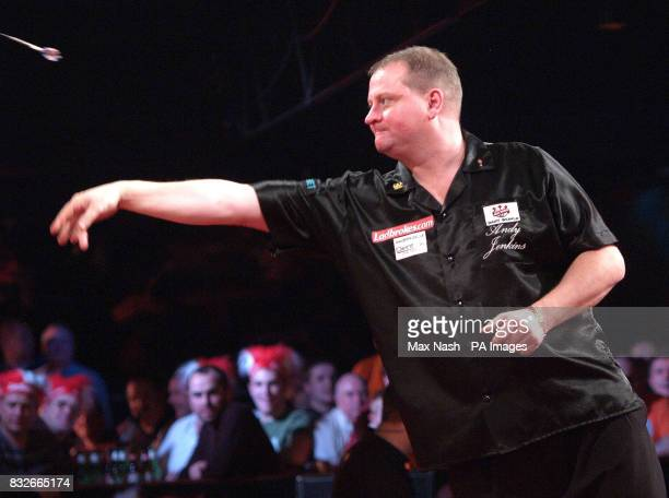 England's Andy Jenkins throws against Raymond van Barneveld of the Netherlands during the semifinal of the PDC Ladbrokescom World Championships at...