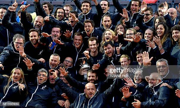 TOPSHOT England's Andy Murray poses with the tennis court crew after winning the men's final match against Serbia's Novak Djokovic at the ATP Tennis...