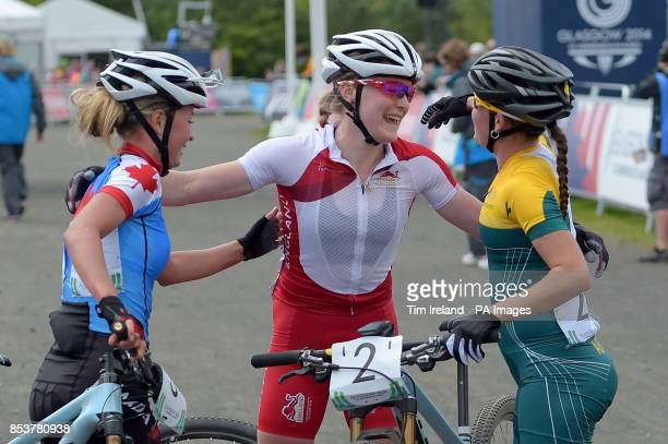 England's Annie Last congratulates Canada's Silver Medalist Emily Batty and Australia's Bronze Medalist Rebecca Henderson after she finished fourth...