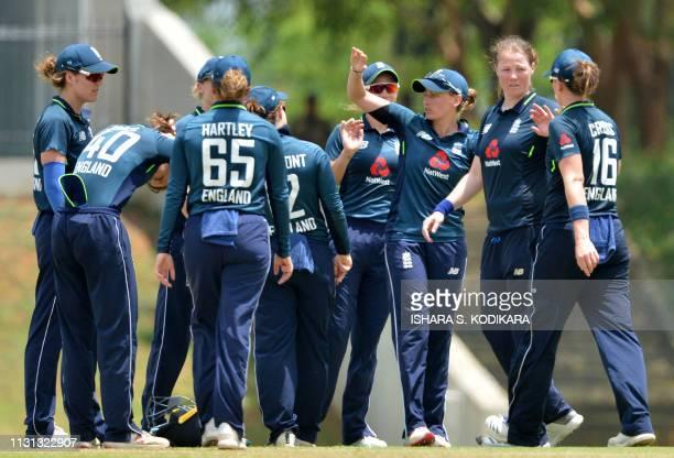 England's Anya Shrubsole celebrates with teammates after dismissing Sri Lanka's Shashikala Siriwardene during the second one day international...