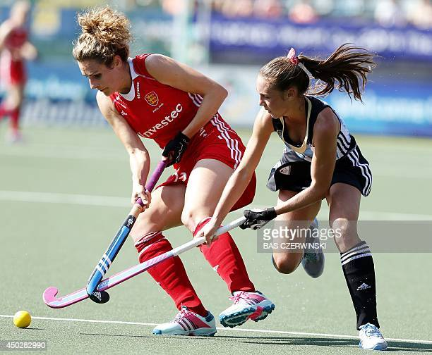 England's Ashleigh Ball and Argentina's Florencia Habif play during a stage match in the women's tournament of the Field Hockey World Cup in The...