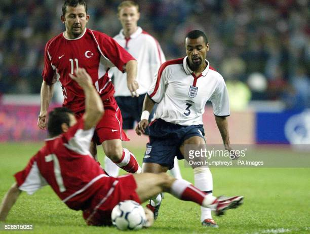 England's Ashley Cole is challenged by Turkey's Okan Buruk and Sergen Yalcin during the European Championships qualifying match at the Sukru...