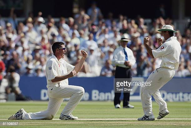 England's Ashley Giles and Michael Vaughan celebrate the dismissal of Chris Gayle of the West Indies during day two of the England v West Indies 1st...