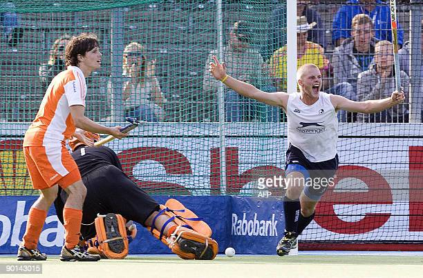 England's Ashley Jackson scores a goal past goalkeeper Dutch Guus Vogels and Dutch defender Wouter Jolie during the semi final of the EC Field Hockey...