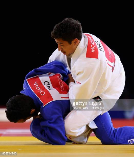 England's Ashley McKenzie in action against India's Navjot Chana during his gold medal winning Men's 60kg Final at the SECC during the 2014...