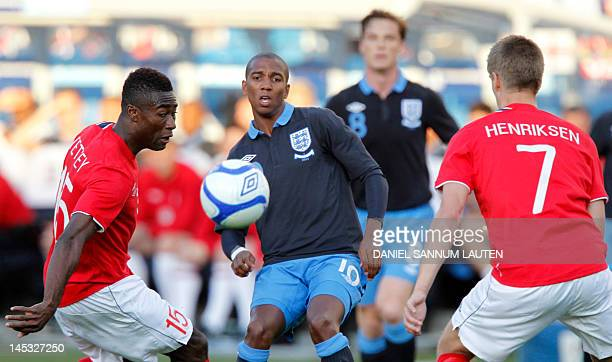 England's Ashley Young vies for the ball with Norway's Alexander Banor Tettey and Norway's Markus Henriksen during the International friendly...
