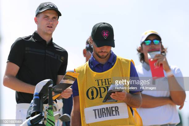 England's Ashton Turner and his caddie during day one of The Open Championship 2018 at Carnoustie Golf Links Angus
