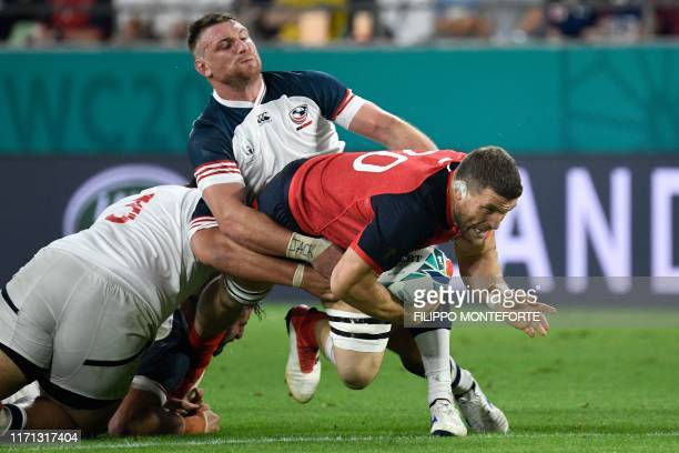 England's back row Mark Wilson is tackled by US flanker Tony Lamborn during the Japan 2019 Rugby World Cup Pool C match between England and the...