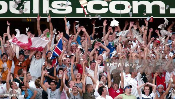 England's 'Barmy Army' enjoy a Mexican wave during play on the third day of the first Test Match at the Gabba in Brisbane 09 November 2002 England...